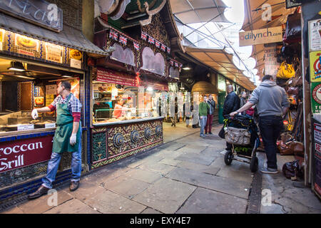 London, United Kingdom - October 10, 2014: View of The Stables at Camden Market in London with workers and visitors - Stock Photo