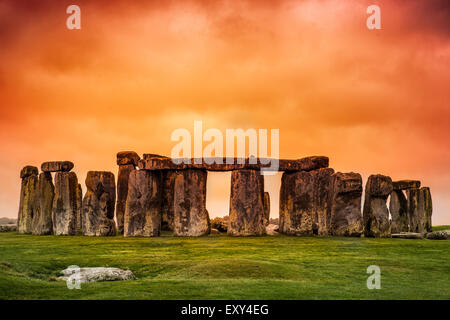 Stonehenge against fiery orange sunset sky - Stock Photo