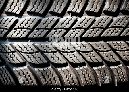 Detail of a winter tire tread on a new motor vehicle tire designed to operate at lower temperature and give additional - Stock Photo
