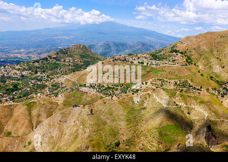 Mount Etna from across the countryside in Messina District view from Taormina, Sicily, Italy - Stock Photo