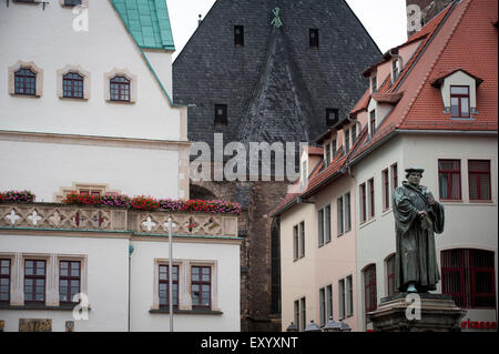 The marketplace in Eisleben where a statue of Martin Luther is placed.Eisleben was Martin Luther's birthplace and - Stock Photo