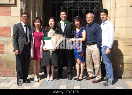 Graduation Day at the University of Leeds asian students celebrate with family members - Stock Photo