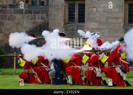 Musket fire, Black powder shoot at Hoghton, Preston, Lancashire, UK. 18th July, 2015.  The Queen's Royal Regiment - Stock Photo
