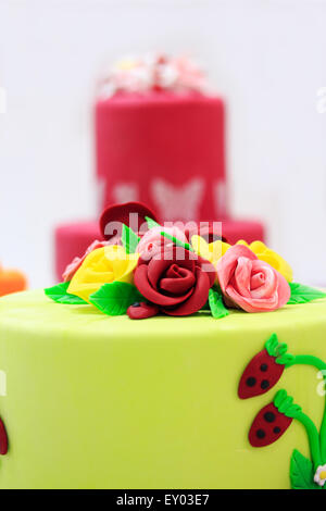 Cake decorated with artificial flowers and berries. - Stock Photo