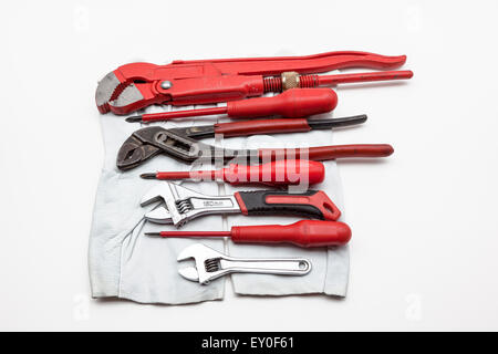 red wrench Isolated on white background whit work gloves - Stock Photo