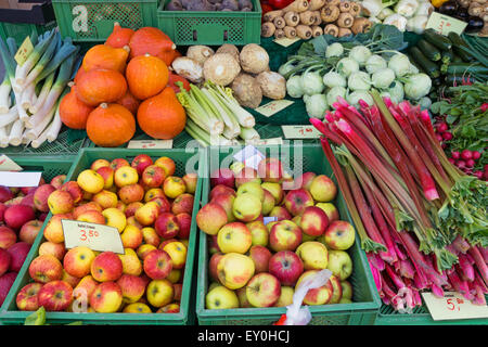 Apples, rhubarb and other vegetables for sale - Stock Photo