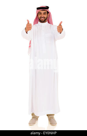 good looking Arabian man giving thumbs up on white background - Stock Photo