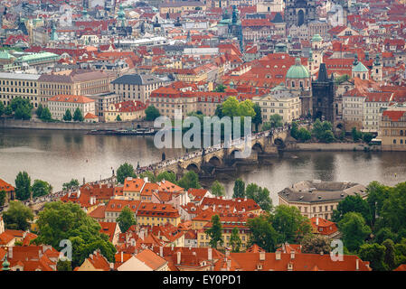 Panoramic View of Prague Charles Bridge over Vlatava River from Petrin Hill, Famous Tourist Attraction and Czech - Stock Photo