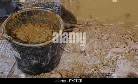 clay bucket on site for rending - Stock Photo