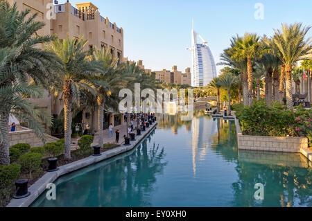Dubai, UAE - January 08, 2012: View of Burj Al Arab from Madinat Jumeirah. Madinat is a luxurious resort in Dubai. - Stock Photo