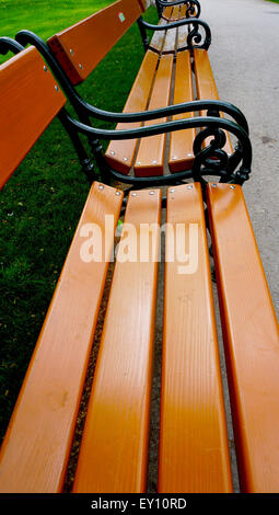 Wooden Bench seat in the park - Stock Photo
