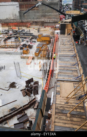 Construction site of Zaha Hadid 520 West 28th Street building next to High Line. NYC, Manhattan, USA. - Stock Photo