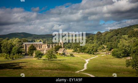 Bolton Abbey and visitors buzzing around the ice cream van on a summer's day - Stock Photo