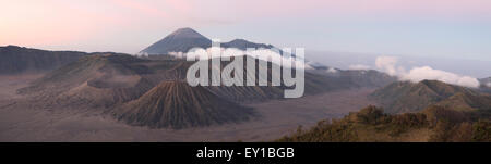 Sunrise over Mount Bromo (2,329 m) and the Tengger Caldera in East Java, Indonesia. Panorama from Mount Penanjakan - Stock Photo