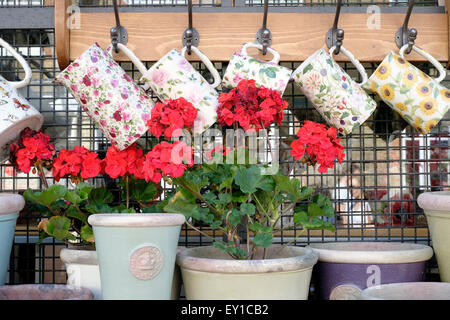 Garden accessories on display in a shop, Columbia Road flower market - Stock Photo