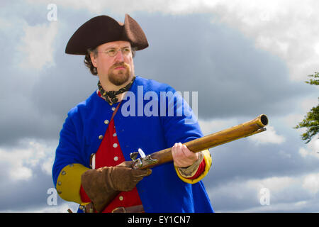 redcoat Jacobite rebellion weapon weapons gun guns firing tricorn hats brims reenactor reenactors reenactment uniform - Stock Photo