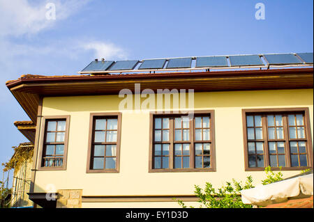 Modern solar panels on a traditional Ottoman style house in Turkey - Stock Photo