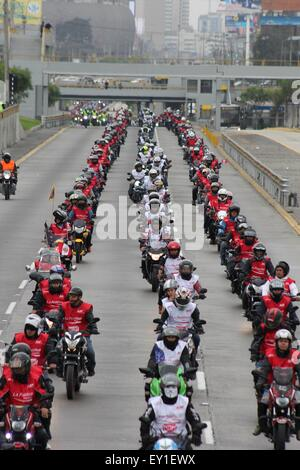 Lima, Peru. 19th July, 2015. Motocyclists take part in the 'Patriotic Motorcycle Parade' in Lima, Peru, on July - Stock Photo