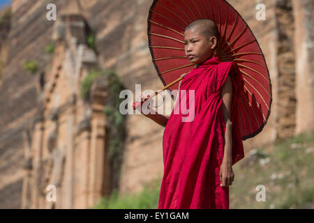 Buddhist novice monk at Mingun Paya pagoda, Myanmar - Stock Photo