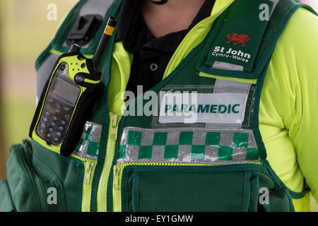 A closeup of a Welsh paramedic / ambulance worker. The Welsh ambulance service are under pressure to improve response - Stock Photo