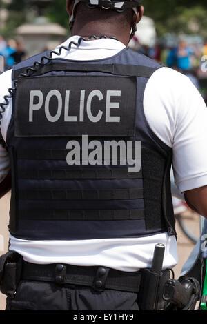 Policeman in bulletproof vest - USA - Stock Photo