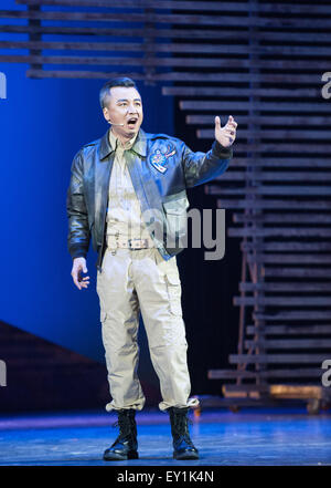 Yuxi, China's Yunnan Province. 19th July, 2015. An actor performs during an original musical drama 'A Thousand Springs' - Stock Photo