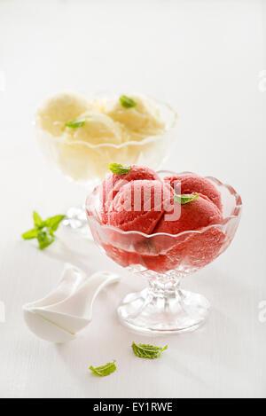 Fresh fruit ice cream in crystal glasses. - Stock Photo