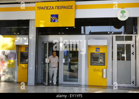 Athens, Greece. 20th July 2015. A customer leaves a Piraeus Bank branch. Greeks bank have re-opened three weeks - Stock Photo