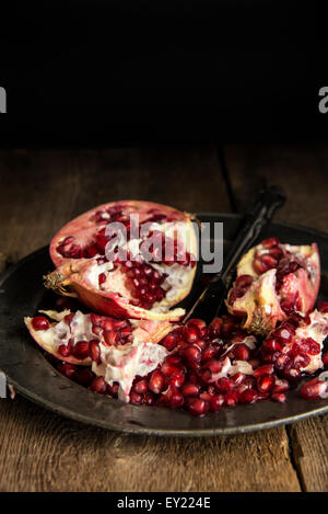 Moody natrual lighting images of fresh juicy pomegranate with vintage style - Stock Photo