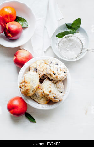 Blueberry scones served with caster sugar and fresh fruits - Stock Photo