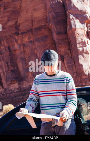Man lost on road trip, Monument Valley, Utah, USA - Stock Photo
