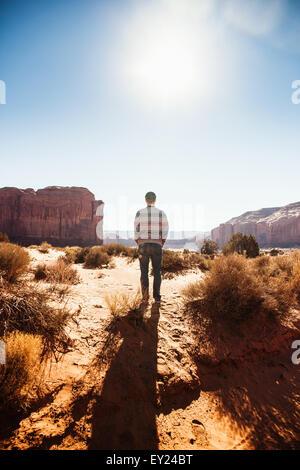 Man taking break on road trip, Monument Valley, Utah, USA - Stock Photo