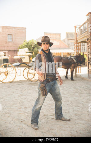 Portrait of cowboy pointing gun on wild west film set, Fort Bravo, Tabernas, Almeria, Spain - Stock Photo