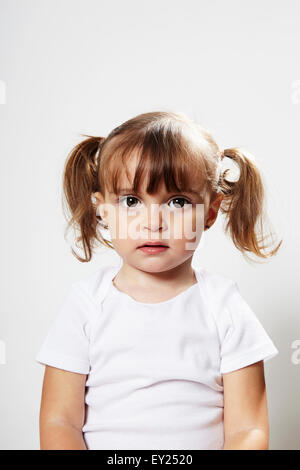 Portrait of young girl with pigtails - Stock Photo