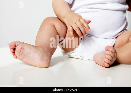 Baby's legs, low section - Stock Photo
