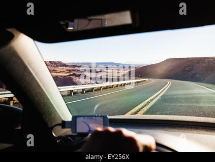 View from inside car driving in Monument Valley, Utah, USA - Stock Photo