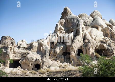 View of rock formation dwellings, Uchisar village, Cappadocia, Anatolia, Turkey - Stock Photo