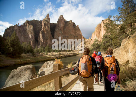 Hikers walking on track, Smith Rock State Park, Oregon, US - Stock Photo