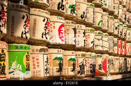 TOKYO, JAPAN - JUNE 25, 2015: traditional sake barrels wrapped in straw at Meiji Shrine in Tokyo, Japan on June - Stock Photo