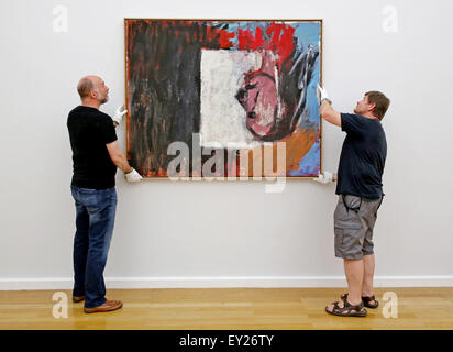 Chemnitz, Germany. 20th July, 2015. Restorer Detlef Goesche (L) and technician Michael Mehlhorn remove the Baselitz painting 'Blick aus dem Fenster' (lit. View from the window) from a wall at the Art Collections Chmenitz in Chemnitz, Germany, 20 July 2015. Two loans of Georg Baselitz were removed from the exhibition. The Saxony based artist reclaimed his loans from German museums in connection to the controversy surrounding the planned cultural protection act ('Kulturschutzgesetz). Photo: Jan Woitas/dpa/Alamy Live News
