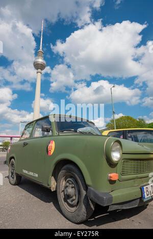 Trabant Berlin, a vintage cold-war era Trabant -or 'Trabi'- parked near the Fernsehturm tower in Alexanderplatz, - Stock Photo