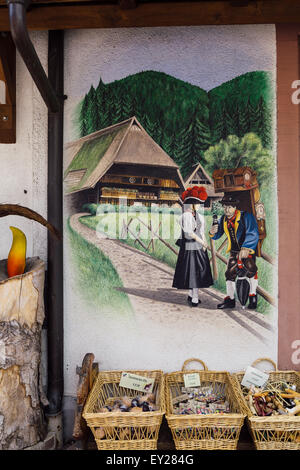 Painted mural on wall of shop, Triberg, Black Forest, Germany - Stock Photo