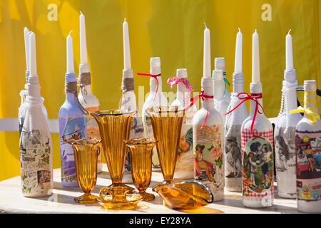vintage retro glassware and decorated bottle candlesticks for sale at Poole Vintage event in July - Stock Photo