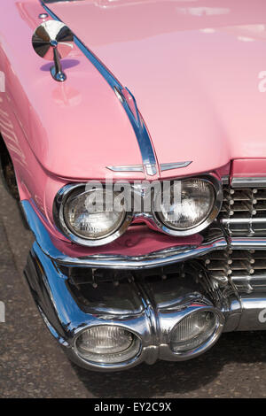 detail of front of Pink Cadillac on display at vintage event at Poole Quay, Dorset, UK in July - Stock Photo