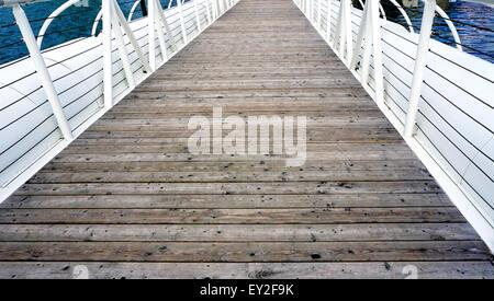 Wooden floor bridge and white railing over Danube river - Stock Photo