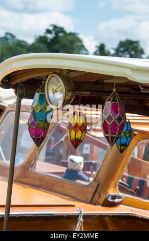 Colourful glass candle holders hanging on a wooden boat at the Thames Traditional Boat Festival, Henley On Thames, - Stock Photo