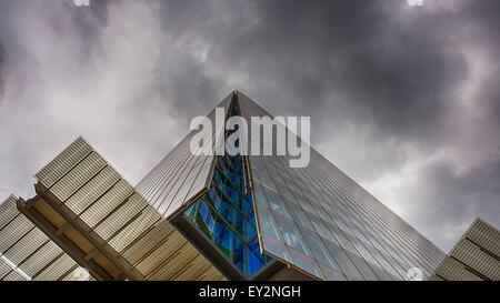 The iconic Shard in London viewed from the base looking up one side of the modern glass building on an overcast - Stock Photo