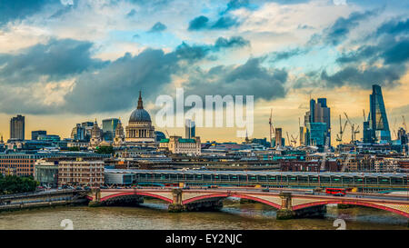 London skyline on a stormy day with the historical landmarks of St Paul's Cathedral, Blackfriars Bridge and the - Stock Photo