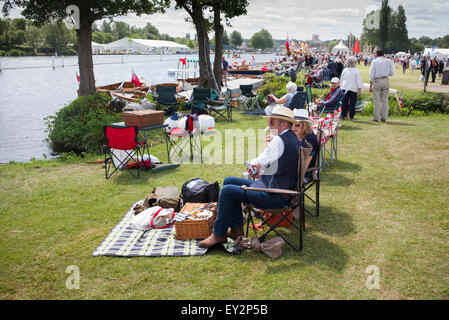 People picnicking at the Thames Traditional Boat Festival, Fawley Meadows, Henley On Thames, Oxfordshire, England - Stock Photo