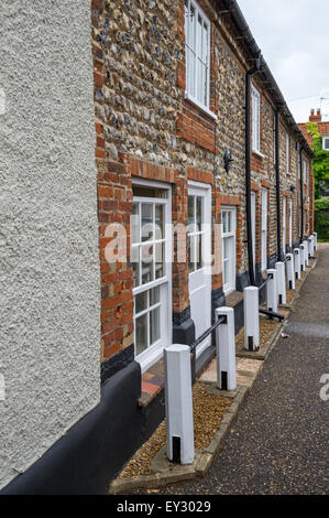 Traditional built cottages of brick and flint in the market town of Burnham Market, Norfolk, England. - Stock Photo